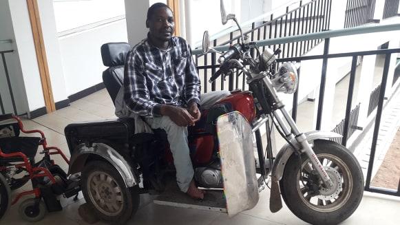 Msafiri in Tanzania - on his adapted motor chair