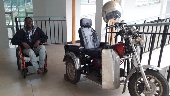 Msafiri in Tanzania - alongside his adapted motor chair